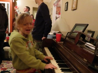 You see how she feels the music? Actually, she was feeling hurt and betrayed because the piano lid had pinched her fingers.