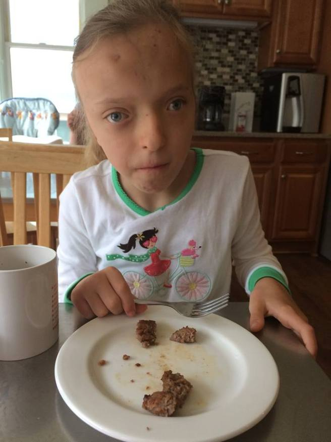 Katya eating breakfast at The Children's House