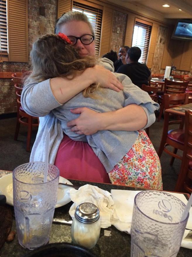 Katya hugging