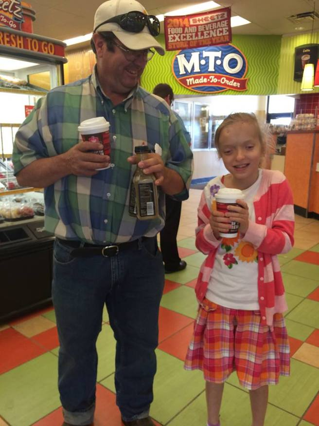 Katya and Daddy with their tea and coffee, respectively. Katya was so happy to get tea!